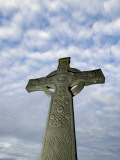 A Celtic Cross Against a Clouded Sky Photographic Print by Jim Richardson