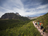 Three Hikers Walk on a Trail with Dramatic Views of Glacier Np, Mt Photographic Print by Michael Hanson