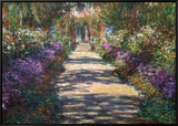 Garden at Giverny Framed Canvas Print by Claude Monet
