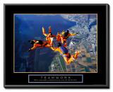 Teamwork: Skydivers Framed Canvas Print