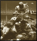 Over The Top: The Redskins vs. The Giants, c.1960 Framed Canvas Print by Robert Riger