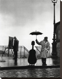 Musician in the Rain Stretched Canvas Print by Robert Doisneau