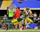 Charles Woodson Action from Super Bowl XLV Photo