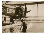 Alan Cobham Climbing into His Plane before Setting Off for Australia, Rochester, 1926 Giclee Print by English Photographer