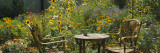 Empty Chairs and a Table in a Garden, Taos, New Mexico, USA Wall Decal by  Panoramic Images