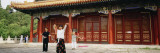 Two Women and a Man Dancing in Front of a Building, the Coal Hill Park, Beijing, China Wall Decal by  Panoramic Images