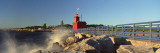 Waves Crashing on Rocks Outside a Lighthouse, Sunset Red Lighthouse, Holland, Minnesota, USA Wall Decal by  Panoramic Images
