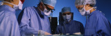 Four Surgeons in an Operating Room, Hospital Wall Decal by  Panoramic Images