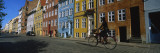 Woman Riding a Bicycle, Copenhagen, Denmark Wallstickers af Panoramic Images,
