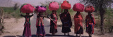 Women Standing on a Road with Luggage on Their Head, Siana, Jodhpur, Rajasthan, India Wall Decal by Panoramic Images 