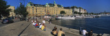 Tourists Sitting on Steps Near a River, Stockholm, Sweden Wall Decal by  Panoramic Images