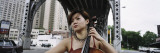 Young Woman Playing a Cello, New York City, NYC, New York State, USA Wall Decal by  Panoramic Images