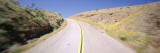 Empty Road Passing through a Hillside, Death Valley National Park, California, USA Wall Decal by  Panoramic Images