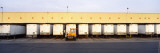 Vehicle Trailers in a Row Parked at a Terminal, Barstow, California, USA Wall Decal by  Panoramic Images