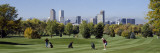 Four People Playing Golf with Buildings in the Background, Denver, Colorado, USA Wall Decal by  Panoramic Images