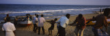 People Pulling a Boat Up to the Shore, Marina Beach, Chennai, Tamil Nadu, India Wall Decal by  Panoramic Images