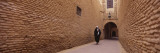 Woman Walking on the Street, Old Town, Tozeur, Tunisia Wall Decal by  Panoramic Images