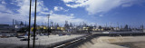 Clouds over an Oil Refinery Wall Decal by  Panoramic Images