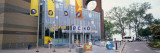 Flags in Front of Building, Echo Lake Aquarium and Science Center, Lake Champlain, Vermont Wall Decal by  Panoramic Images