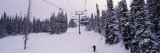 Ski Lift Passing over a Snow Covered Landscape, Keystone Resort, Keystone, Colorado, USA Autocollant mural par Panoramic Images