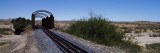 Railroad Track Leading Towards a Railway Bridge, Namibia Wall Decal by Panoramic Images
