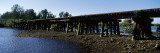 Old Railroad Trestle across a Shallow Bay at Low Tide Showing Oyster Beds, Sarasota County, Florida Wall Decal by  Panoramic Images