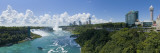 Waterfall in River with New York Skyline in Background, Niagara Falls, Ontario, Canada Wall Decal by Panoramic Images