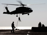 Personnel Fast-Rope out of an SH-60F Seahawk Helicopter Photographic Print by Stocktrek Images