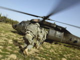 US Army Soldiers Prepare to Board a UH-60 Black Hawk Helicopter Photographic Print by  Stocktrek Images