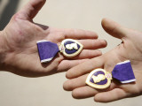 Purple Heart Recipients Display Their Medals in Their Hands Photographic Print by  Stocktrek Images