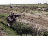 Soldier Scans the Distance with His Rifle's Scope While on a Knock-And-Talk Patrol in Zaidon, Iraq Photographic Print by Stocktrek Images