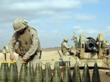 A US Marine Prepares Howitzer Rounds to be Fired Near Baghdadi, Iraq, January 6, 2007 Photographic Print by  Stocktrek Images