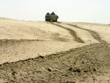 An Amphibious Assault Vehicle Rolls Through a Desert Field North of Fallujah Photographic Print by  Stocktrek Images