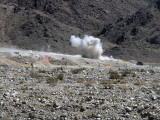 A Round from an At-4 Small Rocket Launcher Impacts on Range 400 Photographic Print by  Stocktrek Images