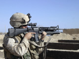 US Marine Sites Through the Scope Atop His 556mm M16A2 Rifle Photographic Print by Stocktrek Images