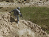 US Army Specialist Climbs Down to the Bottom of a Canal During a Foot Patrol in Iraq Photographic Print by  Stocktrek Images