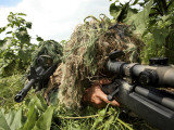 Airmen Hidden in Brush Wearing Their Ghille Suits Photographic Print by  Stocktrek Images