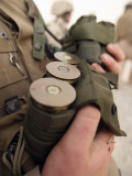 A Marine Cradles Handfuls of 40 mm Grenades During a Training Exercise Photographic Print by  Stocktrek Images
