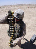A Marine Handles a String of 40 mm High-Explosive Grenades Photographic Print by  Stocktrek Images