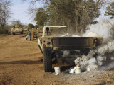 A Humvee Burns after a Simulated Roadside Bomb Explosion Photographic Print by  Stocktrek Images