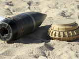 A Static Display of a Converted Ordnance Shell and a Simple Mine Photographic Print by  Stocktrek Images