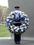 Airman Holds a Wreath While Waiting for a Special Ceremony to Start at the Air Force Memorial Photographic Print by  Stocktrek Images