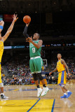 Boston Celtics v Golden State Warriors, Oakland, CA - February 22: Rajon Rondo and Andris Biedrins Photographic Print by Rocky Widner