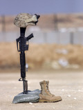 Boots, Rifle, Dog Tags, and Protective Helmet Stand in Solitude to Honor Fallen Soldiers Photographic Print by  Stocktrek Images