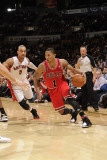 Chicago Bulls v Toronto Raptors, Toronto - February 23: Derrick Rose and Jerryd Bayless Photographic Print by Ron Turenne