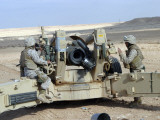 US Marines Prepare to Fire a Howitzer Near Baghdad, Iraq, January 6, 2007 Photographic Print by  Stocktrek Images