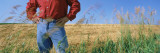Mid Section View of a Farmer in an Oat Field, Saunders County, Nebraska, USA Wall Decal by  Panoramic Images
