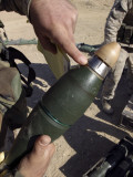 A Squad Leader Points to a Delay Setting on an 81mm Mortar Round, January 1, 2006 Photographic Print by  Stocktrek Images