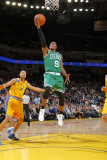 Boston Celtics v Golden State Warriors, Oakland, CA - February 22: Rajon Rondo and Stephen Curry Photographic Print by Rocky Widner