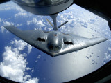A B-2 Spirit Moves into Position for Refueling from a KC-135 Stratotanker Over the Pacific Ocean Photographic Print by  Stocktrek Images